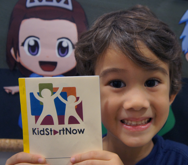J with his KidStartNow reward booklet