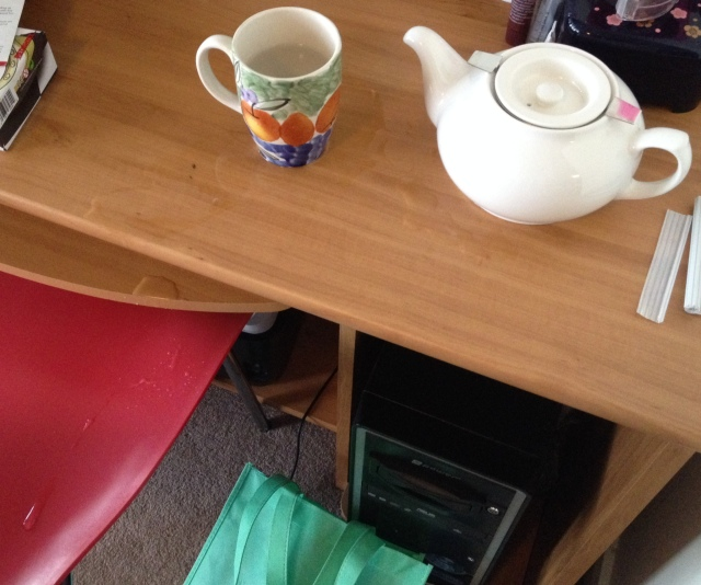 My stupid teapot.  Note the multilevel spill of water on the desk, down the keyboard tray and onto the chair below.  Good thing I didn't waste any actual tea.