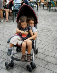 J and Little E sharing a stroller